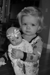 Cora received two baby dolls for Christmas this year.